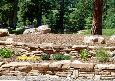 landscape design with flagstone retaining wall