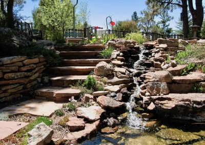 patio landscape design with flagstone stairway and waterfall