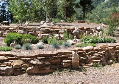 landscape design with with flagstone retaining wall