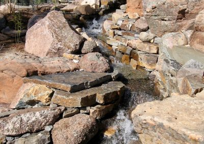 flagstone landscape design with waterfall feature
