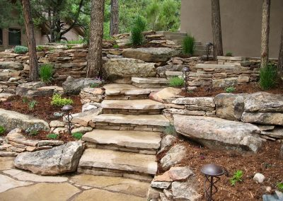 landscape design with retaining walls and flagstone stairway