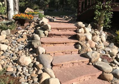 flagstone steps surrounded by flowers