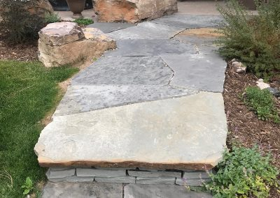 flagstone walkway into a patio