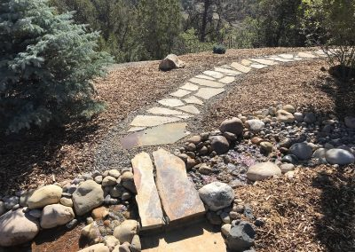stream feature with flagstone walk way