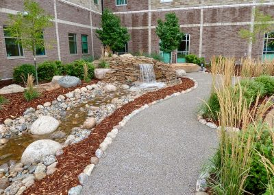 landscape design with waterfall and stream bed